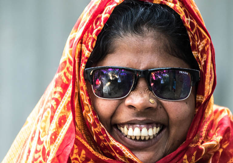 Jahanara wearing a headscarf and sunglasses.
