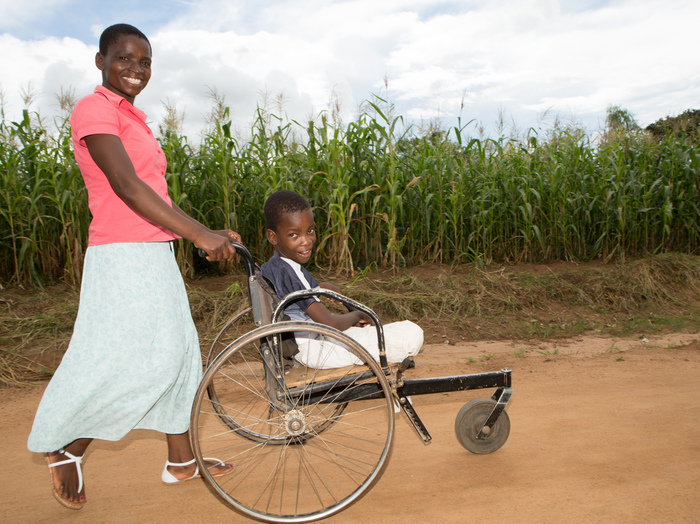 Mirriam and her son Blessings who uses a wheelchair.
