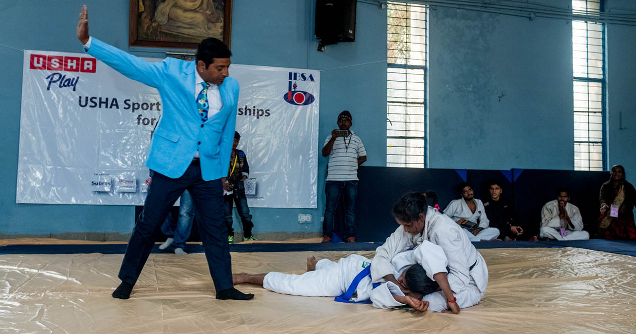 Janki pinning down her competition. Judge in blue is raising his right arm to call the fight.