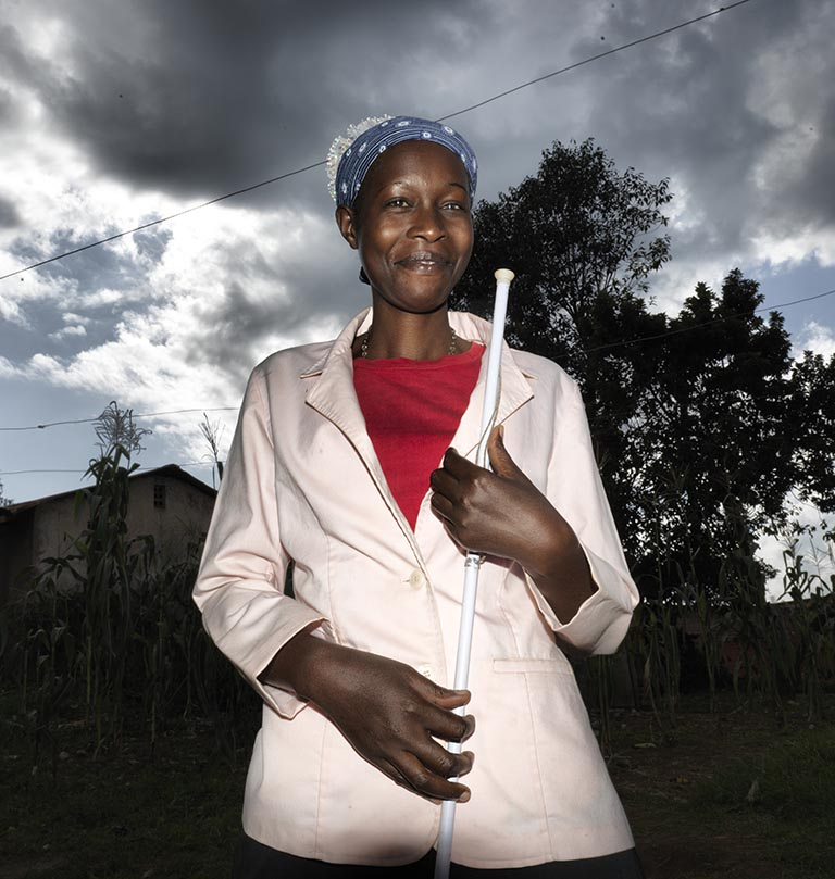 Woman with a white stick.