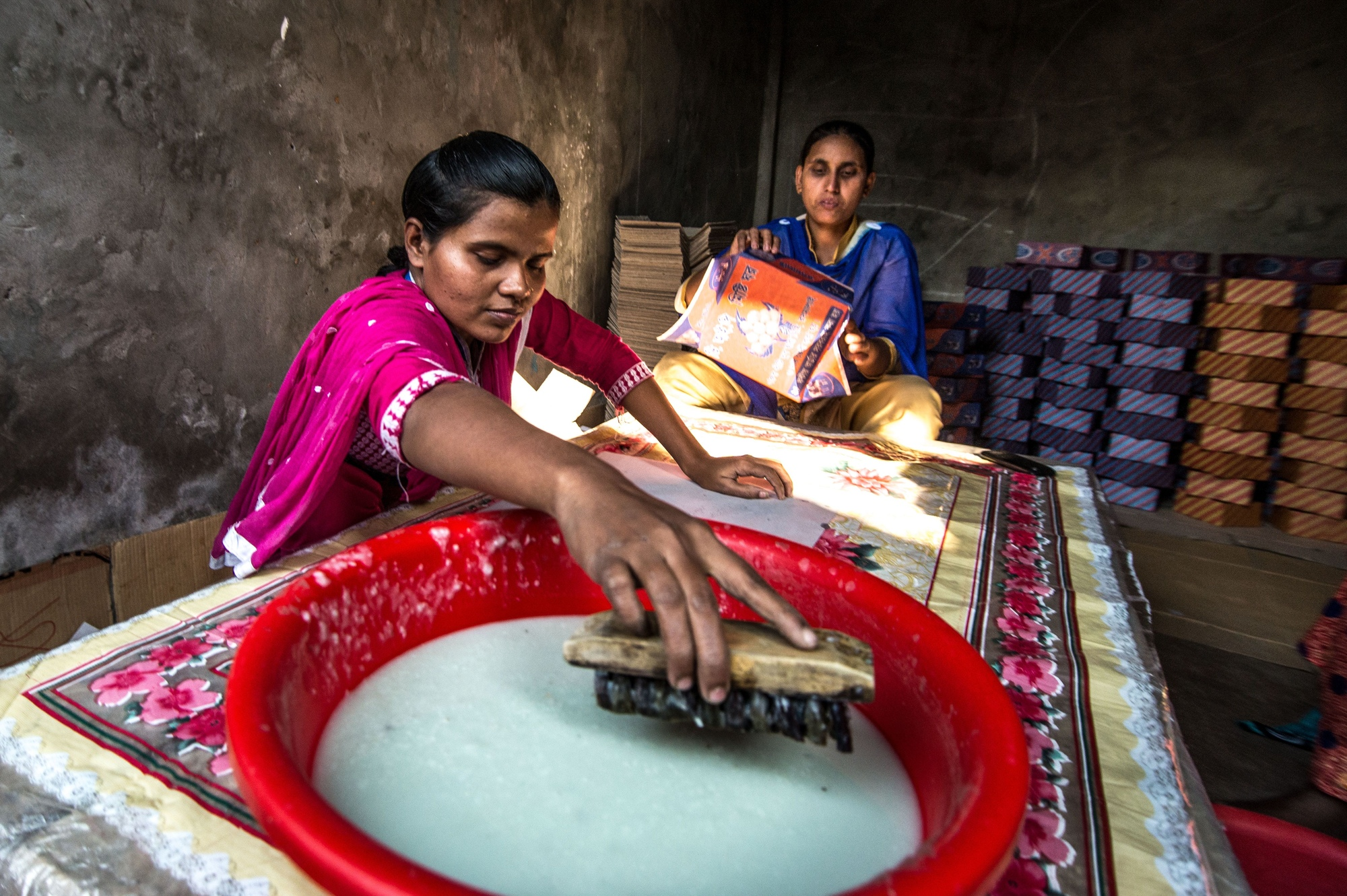 Women with disabilities working at their box-making business in Bangladesh.